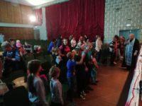 Помощь малоимущим и молебен в Кочковском районе